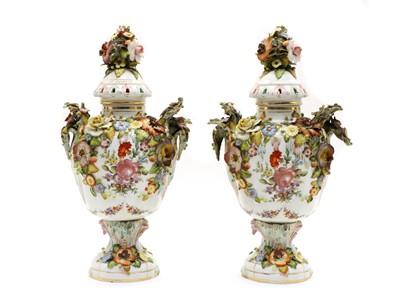 Lot 69 - A pair of Continental lidded porcelain urns