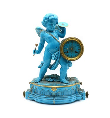Lot 67 - A Continental faience table clock