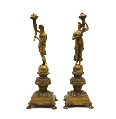 Lot 97 - A pair of figural bronze table lamps