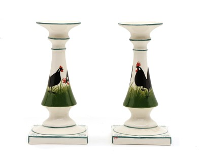 Lot 114 - A pair of candlesticks