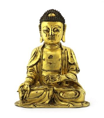 Lot 133 - A Chinese gilt-bronze Buddha