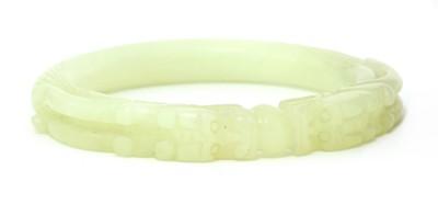 Lot 85 - A Chinese jade bangle