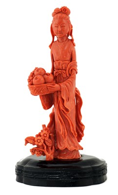 Lot 174 - A Chinese coral figure