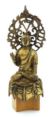 Lot 124 - A Chinese gilt-bronze Buddha