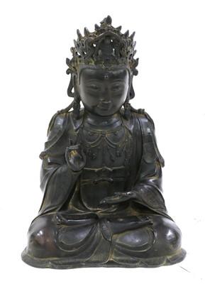 Lot 130 - A Chinese bronze guanyin