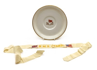 Lot 21 - R M S Cedric, a White Star Line plate and Sailor's Cap Tally for R M S Cedric